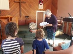 Elinor darts at target